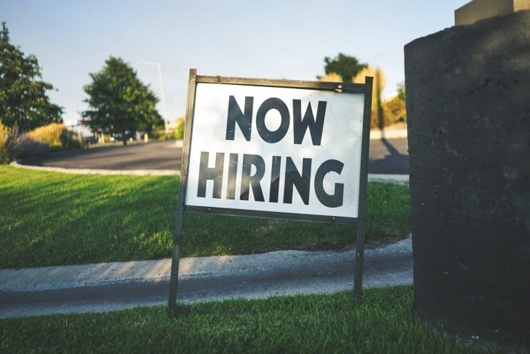 now hiring sign outside